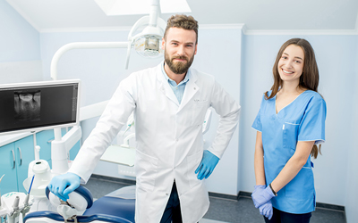 Male dentist and female assistant